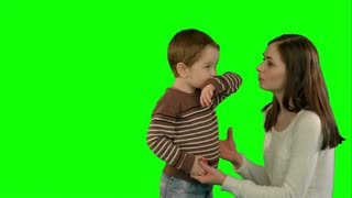 Photo of the happy young family with children looking up on a Green Screen