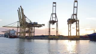 Port cranes in barcelona, on a sunny winter evening