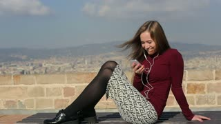 Pretty woman listen music, sing and dance relax on bench