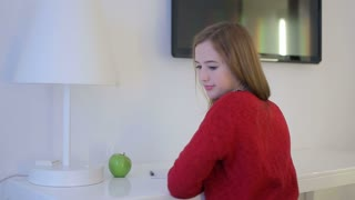 pretty woman thinking and start writeing notes on a white table