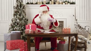 Santa Claus checking his list of presents