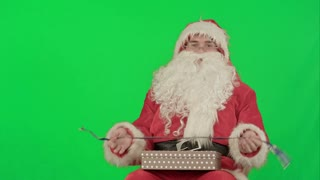 Santa Claus holding Christmas gifts on a Green Screen Chrome Key