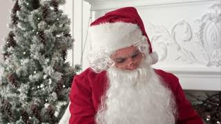 Santa Claus preparing presents for children