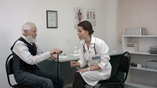 Senior man with osteoarthritis pain in the knees talking to doctor.
