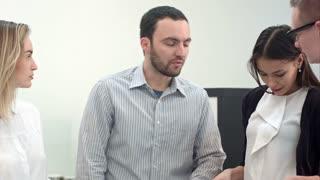 Senior manager explaining tasks to his team