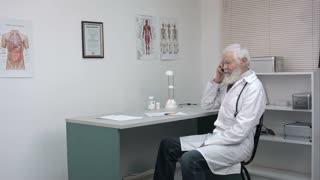Senior pharmacist talking on the phone.