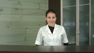 Smiling beauty salon manager at the reception desk