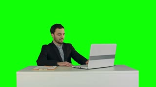 Smiling Businessman in the office on video conference, Skype on a Green Screen