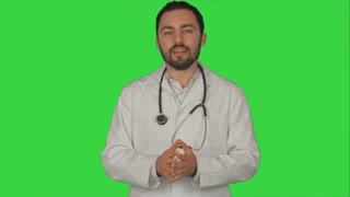 Smiling doctor gesturing thumbs up to camera on a Green Screen, Chroma Key
