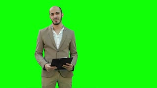 Smiling young man making business presentation on a Green Screen, Chroma Key