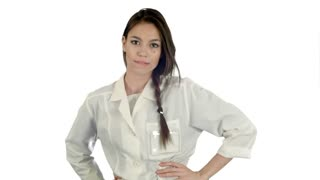 Smiling young woman in lab coat making funny dance on white background