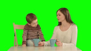 Son with his mother drinking tea on a Green Screen