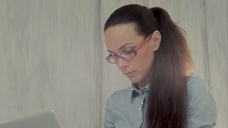 Successful businesswoman working with laptop in office