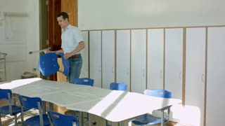 Teachers closed class, placing chairs on tables