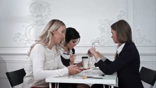 Three beautiful creative business woman working with documents in office