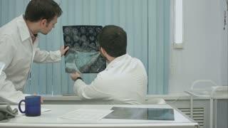 Tutor doctor help intern with x-ray