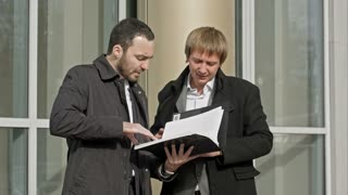 Two businesspeople looking at papers
