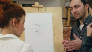 Two male students asking questions about drawing techniques