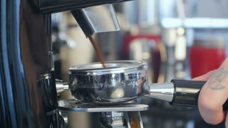 Barista take coffee grind in group