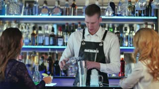 Barman makes cocktails with a shaker