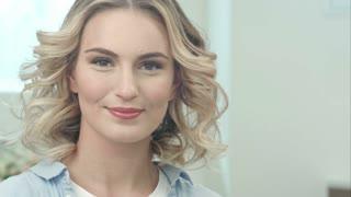 Beauty portrait of beautiful blonde woman smiling at camera