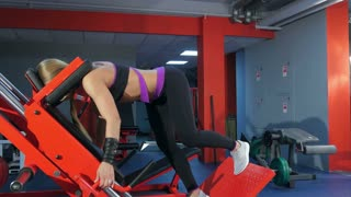 Blonde woman doing butt exercise at the gym