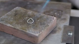 Burning silver in a jewelry