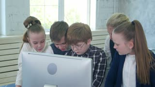 Business children team working together on laptop in office