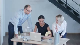 Business people discussing project in modern office