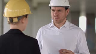 Business people man and woman discussing about building plan for construction at job site