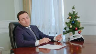Businessman having a serious conversation with a partner before New Year