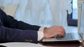 Businessman is typing on laptop computer