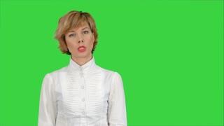 Businesswoman talking to camera on a Green Screen, Chroma Key