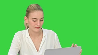 Celebrating success, excited business woman start to dance, working on laptop on a Green Screen, Chroma Key
