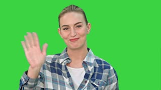 Cheerful young woman talking to a camera on a Green Screen, Chroma Key