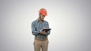 Civil engineer filing in inspection form on white background