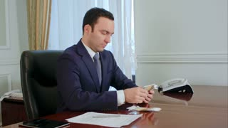 Confident young businessman counting money and planing the budget