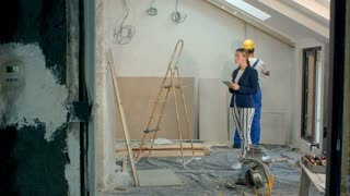 Construction manager controlling building site using digital tablet