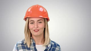 Construction worker talking to camera on white background