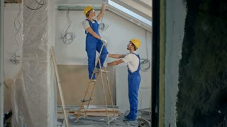 Construction worker wearing worker with tools renovating apartment house