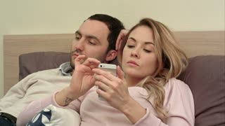Couple relationships problem, conflict sitting on bed because of the jealous