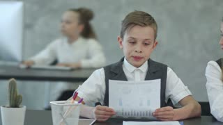 Cute children in business clothing in business center working