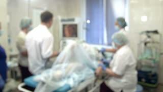 Doctors and nurses performing endoscopic procedure in hospital