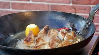 Dumplings baking on a cast-iron frying pan