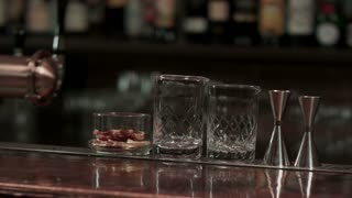 Empty glasses on wooden table in bar