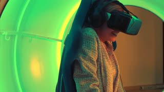 Excited young woman enjoying virtual reality attraction