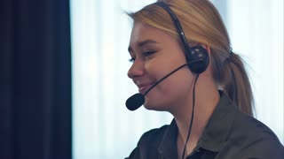 Female customer support operator with headset talking and smiling