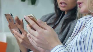 Female hands holding smartphones, women talking