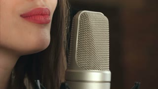Female singer and microphone