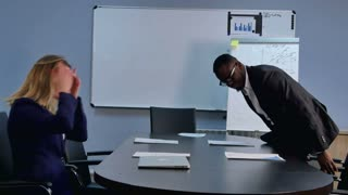 Group of business people coming to an office, taking placec near desk, preparing for a meeting